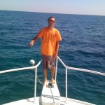Mike mates the boat and enjoys a flat calm day on the water