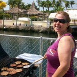 Suzette cooking up burgers and dogs for Sea Ventures